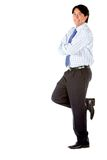 Business man leaning on a wall Royalty Free Stock Images