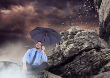 Business man legs crossed with umbrella and mist against falling rocks. Digital composite of Business man legs crossed with umbrella and mist against falling royalty free illustration