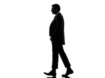Business man lifting his pants walking silhouette Royalty Free Stock Image