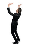 Business man lifting something Royalty Free Stock Images