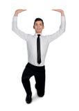 Business man  lifting something Stock Photography