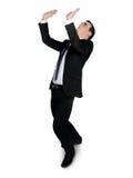 Business man lifting something Royalty Free Stock Image