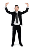 Business man lifting something Royalty Free Stock Image
