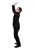 Business man lifting something Stock Images