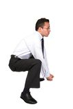 Business man lifting something up Stock Photography