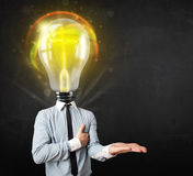 Business man with light bulb head concept Royalty Free Stock Photo