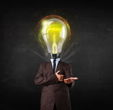 Business man with light bulb head concept Stock Photos