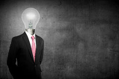 Business man with light bulb head show thumb up Royalty Free Stock Photo