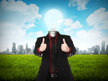 Business man with light bulb head show thumb up Stock Images