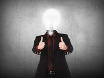 Business man with light bulb head show thumb up Stock Photos