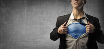 Business man like superman. Business man is playing superman royalty free stock images