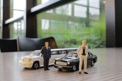 Business man with limosine car Stock Images