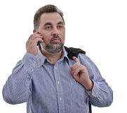 Business man listening at mobile phone Stock Photography