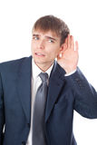 Business man in listening pose isolated Stock Image