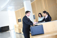 Business Man in Lobby Royalty Free Stock Images