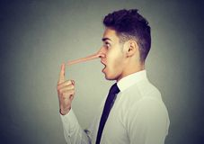 Business man with long nose. Liar concept. stock photography