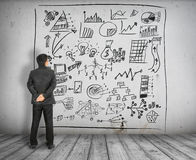 Free Business Man Look At Business Concept Chart On Wall Royalty Free Stock Image - 42487496