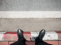 Business man look down to street. Royalty Free Stock Images