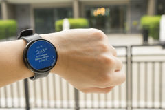 Business man look smartwatch for checking time to meeting Royalty Free Stock Photos