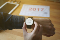 Business man look smartwatch for checking time to meeting at coffee shop Stock Image