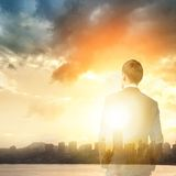 Business man look sunrise in the city Stock Photos