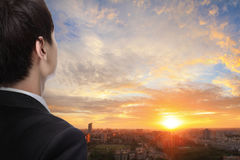 Business man look sunrise in the city Stock Photography