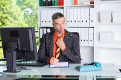 Business man looking amazed at desk Stock Photo