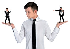 Business man looking angry on little man Royalty Free Stock Photography