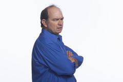 Business man looking annoyed, horizontal. Annoyed man with arms crossed against chest Royalty Free Stock Photography
