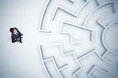 Free Business Man Looking At Circular Maze With Nowhere To Go Royalty Free Stock Photography - 82504527