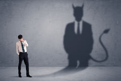 Free Business Man Looking At His Own Devil Demon Shadow Concept Stock Photography - 96872832
