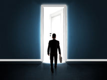 Business man looking at big bright opened door Stock Photos