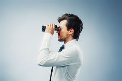 Business man with binocular Stock Photos
