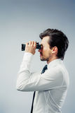 Business man with binocular. Business man looking through binocular Royalty Free Stock Photography