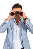 Business man looking through binocular Royalty Free Stock Images