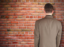 Business Man Looking at Brick Wall Obstacle royalty free stock images