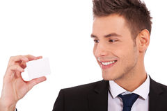 Business man looking at a card Stock Images