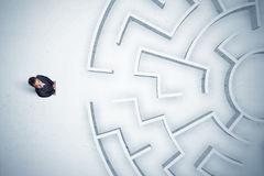 Business man looking at circular maze with nowhere to go Royalty Free Stock Images