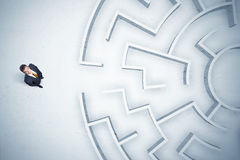 Business man looking at circular maze with nowhere to go Stock Image