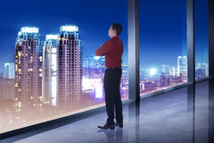 Business man looking the city from his office room Stock Photo