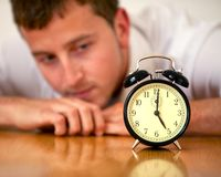 Business man looking at a clock Stock Photography