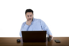Business Man Looking At Computer Screen Royalty Free Stock Photography
