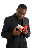 Business man looking at gift box Royalty Free Stock Image