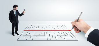 Business man looking at hand drawing solution for maze Royalty Free Stock Photo
