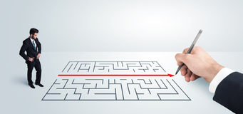 Business man looking at hand drawing solution for maze Stock Photos