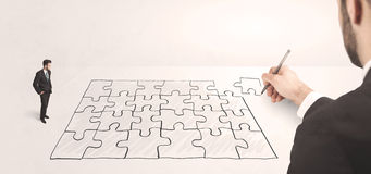 Business man looking at hand drawing solution Royalty Free Stock Photo
