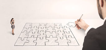 Business man looking at hand drawing solution Stock Images