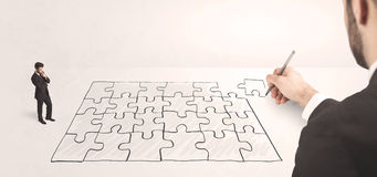 Business man looking at hand drawing solution Stock Image