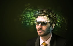 Business man looking at high tech number calculations Royalty Free Stock Photos