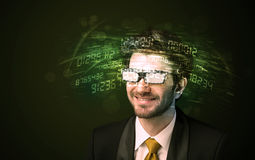 Business man looking at high tech number calculations Stock Images